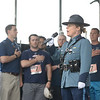 JIM VAIKNORAS/Staff photo Massachusetts State Trooper Kathryn Downey sings the National Anthem at the 5th Annual Flag Day 5k at Cashman Park.  Behind her are men who served with Derek Hines.