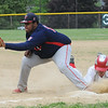 BRYAN EATON/Staff Photo. Amesbury's Kelleher is safe at first after a steal attempt.
