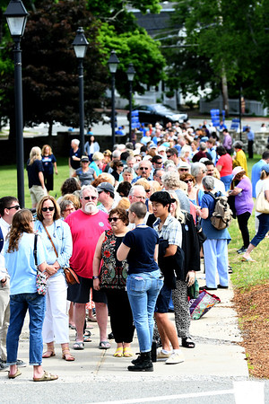 JIM VAIKNORAS/Staff photo  A large crowd waits outside Newburyport High School Saturday morning to hear Senator Elizabeth Warren speak.