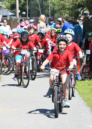 JIM VAIKNORAS/Staff photo Riders take off from Cashman Park in the 7th annual PMC Kids Ride in Newburyport Sunday. Over 125 kids, ages 3-13 participated in the event to raise money for cancer care and research.