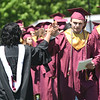 JIM VAIKNORAS/Staff photo Graduating senior Luke Berger high fives class advisor Shannon Osgood at World War Memorial Stadium in Newburyport Sunday.