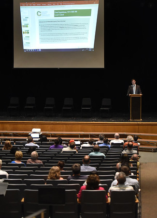 "BRYAN EATON/Staff photo. David Lakeman, director of goverment affairs of the Cannabis Control Commission, speaks at a community forum on marijuana retail, discussing the potential options Newburyport has in terms of ""pot shops."""