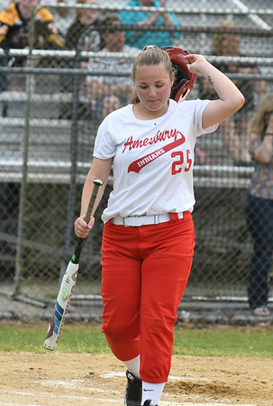 JIM VAIKNORAS/Staff photo Amesbury's Sydney Dalleanes walks back to the dugout after striking out against Austin Prep at Martin Field in Lowell Saturday. The Indians fell to Austin Prep 3-0.