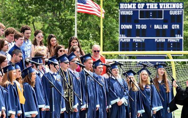 """BRYAN EATON/Staff photo. The graduating seniors rejoin the chorus for the number """"My Wish."""""""