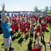 JIM VAIKNORAS/Staff photo Newburyport teacher Jay Murphy leads kids in a pre-ride stretch at the 7th annual PMC Kids Ride in Newburyport Sunday. Over 125 kids, ages 3-13 participated in the event to raise money for cancer care and research.