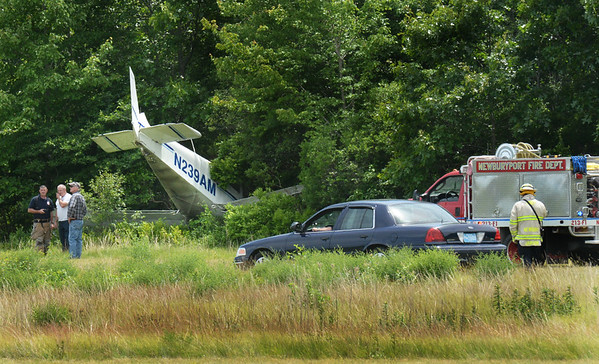BRYAN EATON/Staff photo. The pilot, who was the only person on board this plane, was uninjured when he overshot the runway at Plum Island Airport early Wednesday afternoon. There was no fuel spill and the FAA was scheduled to check it out before being taken out of the woods.