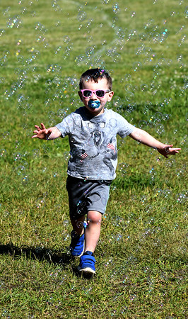 JIM VAIKNORAS/Staff photo Max Dower, 3,plays in a sea of bubbles at the 7th annual PMC Kids Ride in Newburyport Sunday. Over 125 kids, ages 3-13 participated in the event to raise money for cancer care and research.