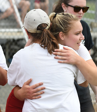 JIM VAIKNORAS/Staff photo Amesbury senior captain Hayley Catania hugs coach Jackie Waters after the teams 3-0 lose to Austin Prep at Martin Field in Lowell Saturday.