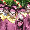 JIM VAIKNORAS/Staff photo Newburyport graduating senior Emma Vandenberg waves to the crowd as she marches in to graduation with her class mates Sunday.