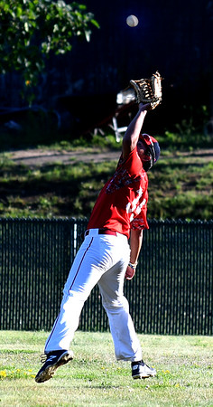 JIM VAIKNORAS/Staff photo Nor'Easter player Josh O'Brien makes a play in the outfieldl against Peabody /Middleton at Eiras Field in Rowley Friday.