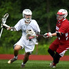 BRYAN EATON/Staff photo. Pentucket's Alex Satkus moves around a Saugus player.