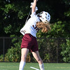 JIM VAIKNORAS/Staff photo Newburyport 's Molly Laliberty goes high for a save during the Clippers 14-11 lose to Norwell in the State semi-final game at Babson College Tuesday night.