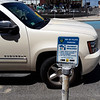 BRYAN EATON/Staff photo. The need to pay for parking at kiosks are clear on meter poles on Broadway at Salisbury Beach.