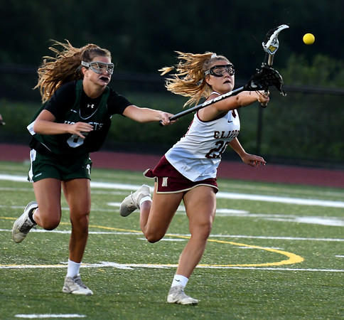 JIM VAIKNORAS/Staff photo Newburyport's Maggie Pons out races Manchester-Essex player Heather Holley during  the North Final against at Triton in Byfield. Newburyport won the game 17-8.