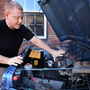 BRYAN EATON/Staff photo. Brown shows off the electric components under the hood of his Jeep.