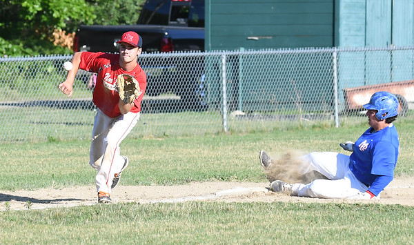 JIM VAIKNORAS/Staff photo Nor'Easter player Cam Janis waits for a throw on a steal against Peabody /Middleton at Eiras Field in Rowley Friday.