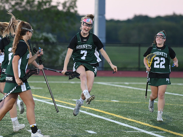 JIM VAIKNORAS/Staff photo  Manchester-Essex player Christina Calandra celebrates a goal against Newburyport during the North Final against at Triton in Byfield. Newburyport won the game 17-8.