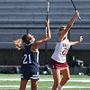 JIM VAIKNORAS/Staff photo Newburyport's Maggie Pons wins a face off  against Swampscott's Harper Clopton during their game at World War Memorial Stadium in Newburyport Tuesday.