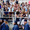 BRYAN EATON/Staff photo. Spectators wave to Triton graduates as they march into ceremonies at the school on Saturday.