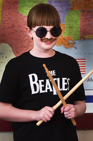 """BRYAN EATON/Staff photo. Danika Prendergast, 10, waits for a fellow schoolmate to push a button to bring her character, Ringo Starr of the Beatles to life, during the Wax Museum at the Pine Grove School in Rowley. When asked what the greatest band of all-time was she said without hesitation """"the Beatles."""""""