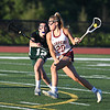 JIM VAIKNORAS/Staff photo Newburyport's Maggie Pons makes a move during the North Final against Manchester Essex at Triton in Byfield. Newburyport won the game 17-8.