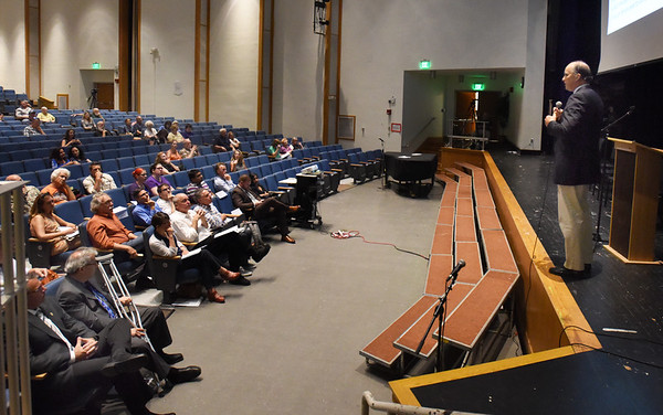 BRYAN EATON/Staff photo. Jim Borghesani, a marijuana consultant and spokesman for the 2016 legalization campaign, speaks at a forum regarding retail marijuana sales in Newburyport in front of about 90 people Tuesday night at the Nock Middle School.