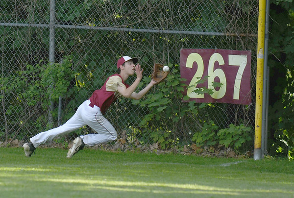 JIM VAIKNORAS/Staff photo Newburyport's Nicholas White makes a diving catch at the right field foul pole during the Clipper's game against Watertown Friday at Pettingell Park in Newburyport. Newburyport won the game 3-0.