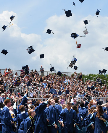 BRYAN EATON/Staff photo. Triton graduates toss their caps into the air.