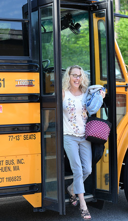 BRYAN EATON/Staff photo. Michelle Howard arrives for her last day of teaching at Salisbury Elementary School on a school bus arrange by her husband, Thomas Howard, who was the head of the Newburyport Police Department.