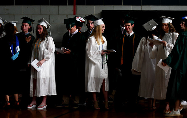JIM VAIKNORAS/Staff photo Graduating seniors hang around in the gym before commencement at the school Saturday morning.