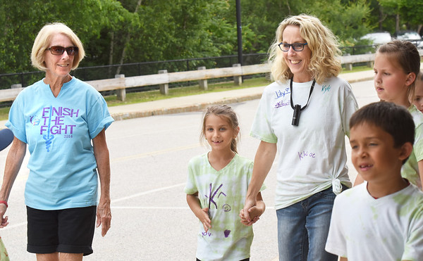 BRYAN EATON/Staff photo. Marie Roy, left, with her daughter Michelle Howard on the Mini Relay For Life.