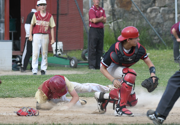 JIM VAIKNORAS/Staff photo Newburyport's Thomas Murphy scores one of his 2 runs during the Clipper's game against Watertown Friday at Pettingell Park in Newburyport. Newburyport won the game 3-0.