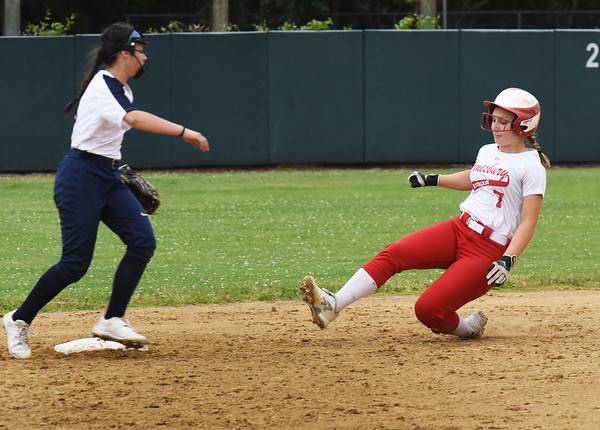 BRYAN EATON/Staff photo. Hayley Catania makes it to second as Emma DiPietro ran in to home plate from third base.