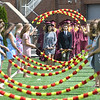 JIM VAIKNORAS/Staff photo Graduating seniors march through the Arch of Roses at World War Memorial Stadium in Newburyport Sunday.