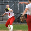 BRYAN EATON/Staff photo. Catania throws to first baseman Emily O'Donnell forcing out St. Mary's Taylor Sullivan.
