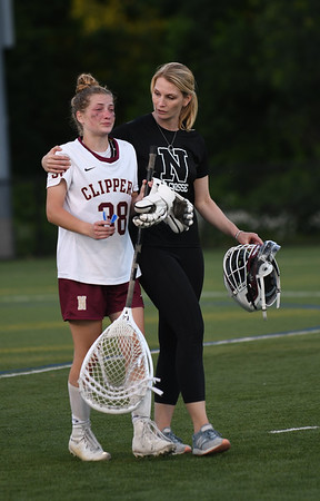 JIM VAIKNORAS/Staff photo Newburyport coach Cyndi Doyle consoles goalie Molly Laliberty after the Clippers 14-11 lose to Norwell in the State semi-final game at Babson College Tuesday night.