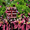 JIM VAIKNORAS/Staff photo Graduating seniors toss their caps at World War Memorial Stadium in Newburyport Sunday.