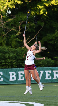 JIM VAIKNORAS/Staff photo Newburyport's Molly Rose Kearney goes high for a ball during the Clippers 14-11 loss to Norwell in the State semi-final game at Babson College Tuesday night.