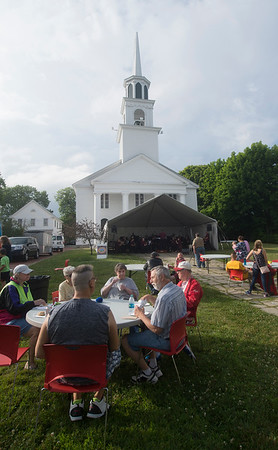 JIM VAIKNORAS/Staff photo People enjoy some food from local restaurants as the Merrimack Valley Concert Band performs at the Amesbury Day's Block Party Thursday Night a the Main Street Congregational Church.