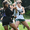 BRYAN EATON/Staff photo. Angelina Yacubacci gets in the way of a Shawsheen player.