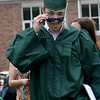 JIM VAIKNORAS/Staff photo Pentucket graduating senior Conor Logan winks after getting his diploma at the school Saturday morning.
