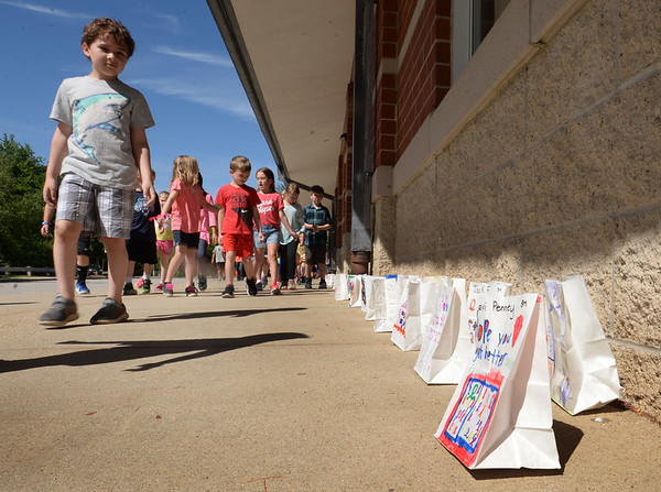 BRYAN EATON/Staff photo. Salisbury Elementary School students participate in the Mini Relay for Life raising money for the American Cancer Society. They're walking past Bags of Hope which are placed with the memory of someone who died of cancer, a survivor and words of encouragement.