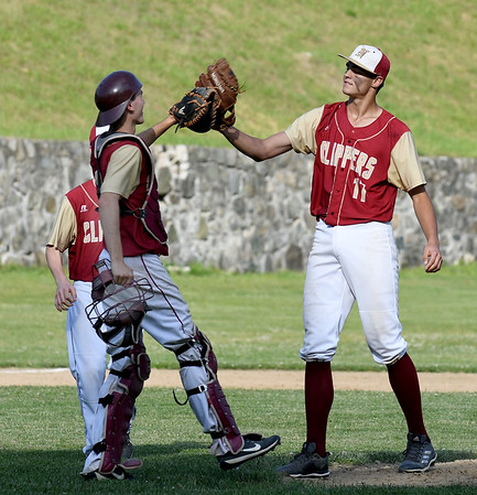 JIM VAIKNORAS/Staff photo Newburyport's Casey McLaren high-fives teammate Kenny Hodge after the Clipper's game against Watertown Friday at Pettingell Park in Newburyport. Newburyport won the game 3-0.