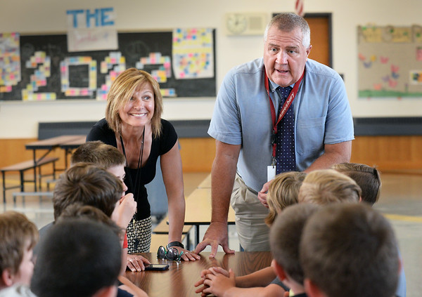 BRYAN EATON/Staff photo. Amesbury Middle School vice-principals Kathy Randall, left, and Steve O'Connor who is retiring after 20 years, meet with students during lunch.
