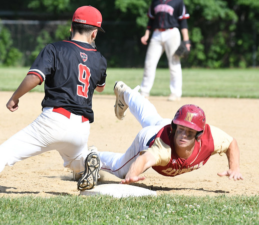JIM VAIKNORAS/Staff photo Newburyport's Walker Bartkiewicz dives safely back to first during the Clipper's game against Watertown Friday at Pettingell Park in Newburyport. Newburyport won the game 3-0.