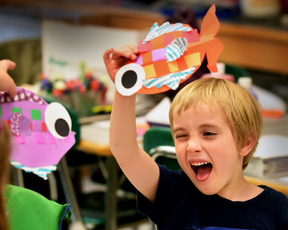BRYAN EATON/Staff photo. Hurley Thompson, 5, and classmates wave around the flying fish they made in Aimee Farrell's class at Salisbury Elementary School. The kindergartners were learning about life in the oceans and creating projects to go with the lessons.