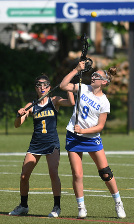 JIM VAIKNORAS/Staff photo Georgetown's Abbie Donahue fights for the ball on a faceoff against Marion at Georgetown high Thursday.
