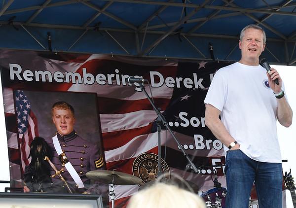 BRYAN EATON/Staff photo. Gov. Charlie Baker speaks at the start of the Derek Hines Flag Day 5K Race.