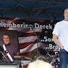BRYAN EATON/Staff photo. Gov. Charlie Baker speaks at the start of the Derek Hines Flag Day 5K Race.