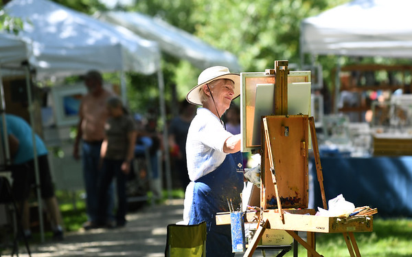 JIM VAIKNORAS/Staff photo Newburyport artist Sue Spellman paints a landscape along the Rail Trail in Salisbury at the annual Art Walk Sunday morning.